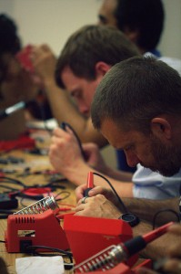 Soldering during Summer School 2013 kickoff kit-build